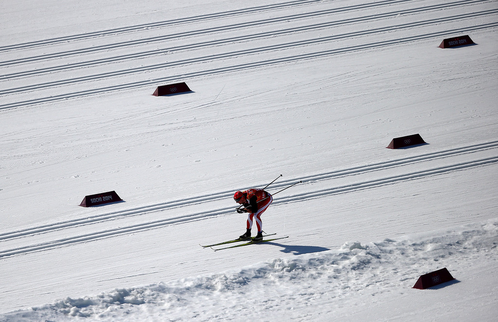 . Maciej Kreczmer of Poland competes in the first leg of the Men\'s 4 x 10 km Relay during day nine of the Sochi 2014 Winter Olympics at Laura Cross-country Ski & Biathlon Center on February 16, 2014 in Sochi, Russia.  (Photo by Clive Mason/Getty Images)