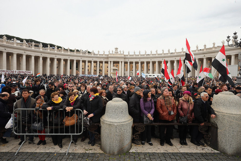 . People gather in St Peter\'s Square ahead of the arrival of Pope Francis who will give his first Angelus Blessing to the faithful from the window of his private residence on March 17, 2013 in Vatican City, Vatican. The Vatican is preparing for the inauguration of Pope Francis on March 19, 2013 in St Peter\'s Square.  (Photo by Dan Kitwood/Getty Images)