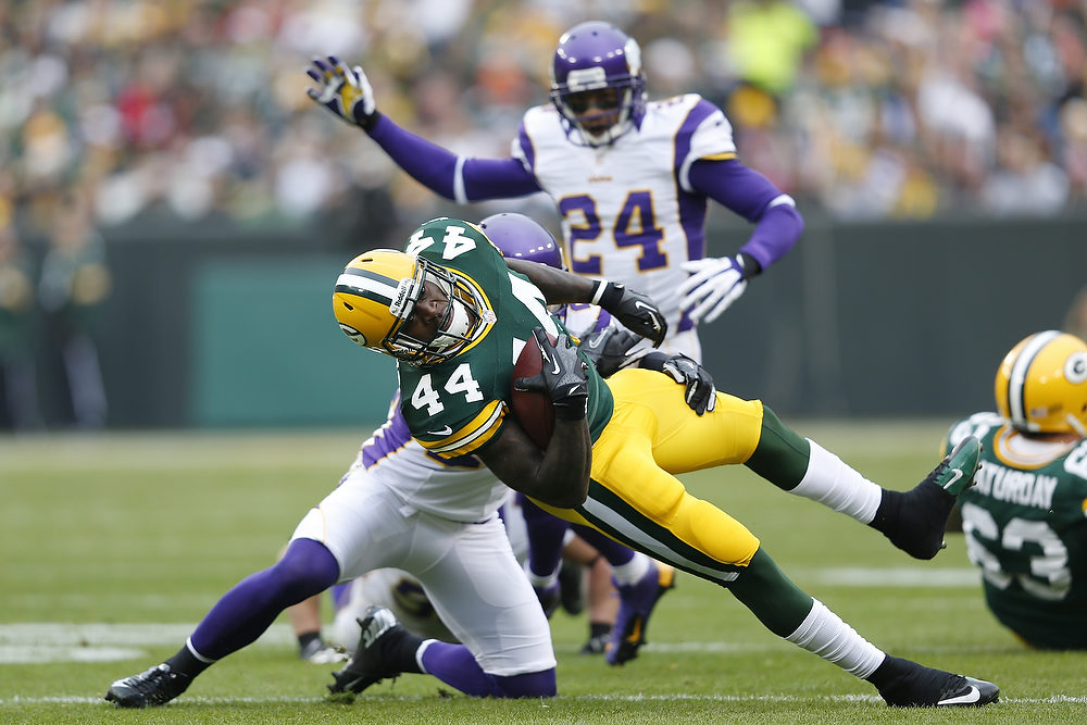 . James Starks #44 of the Green Bay Packers gets tackled while running with the ball against the Minnesota Vikings during the game at Lambeau Field on December 2, 2012 in Green Bay, Wisconsin. The Packers won 23-14. (Photo by Joe Robbins/Getty Images)