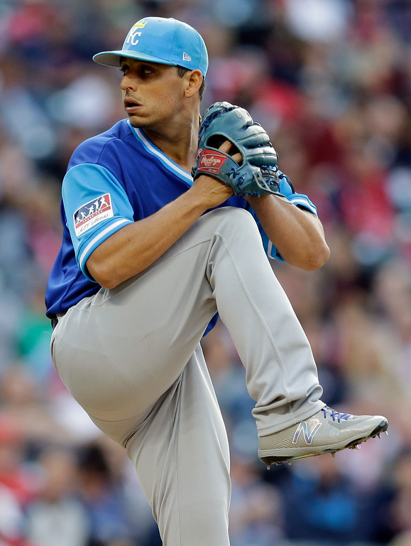 . Kansas City Royals starting pitcher Jason Vargas winds up during the first inning of a baseball game against the Cleveland Indians, Friday, Aug. 25, 2017, in Cleveland. (AP Photo/Tony Dejak)