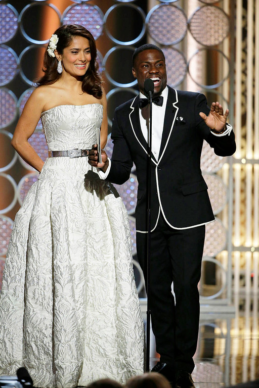 . In this image released by NBC, Salma Hayek, left, and Kevin Hart present an award at the 72nd Annual Golden Globe Awards on Sunday, Jan. 11, 2015, at the Beverly Hilton Hotel in Beverly Hills, Calif. (AP Photo/NBC, Paul Drinkwater)