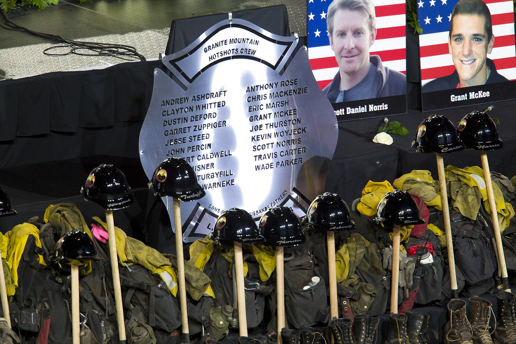 . Memorabilla are displayed during a memorial service honoring 19 fallen firefighters at Tim\'s Toyota Center July 9, 2013 in Prescott Valley, Arizona.  (Photo by Michael Chow-Pool/Getty Images)