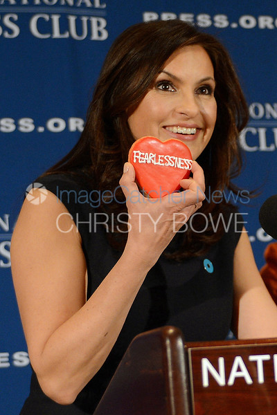"Actress  Mariska Hargitay of Law and Order SUV speaks to reporters about founding the Joyful Heart Foundation which helps real life victims of sexual abuse, rape and domestic violence. Hargitay holds up a ""fearlessness"" cookie describing  the goals of her foundation."