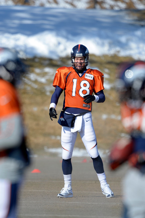 . Denver Broncos quarterback Peyton Manning (18) looks on after his pass during practice January 23, 2014 at Dove Valley.   (Photo by John Leyba/The Denver Post)