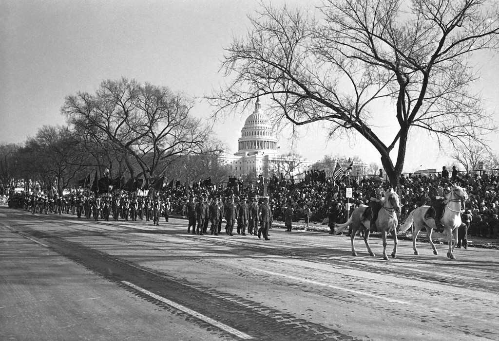 . The Capitol is in background as members of the Massachusetts 26th Infantry Division parade up Constitution Avenue in the inaugural parade for President John F. Kennedy, Jan. 20, 1961 in Washington. (AP Photo)
