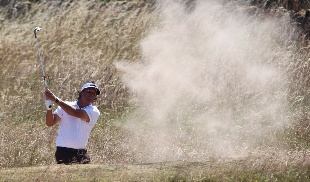 . US golfer Phil Mickelson plays a shot out of a bunker on the second fairway during the second round of the 2013 British Open Golf Championship at Muirfield golf course at Gullane in Scotland on July 19, 2013 .  PETER MUHLY/AFP/Getty Images