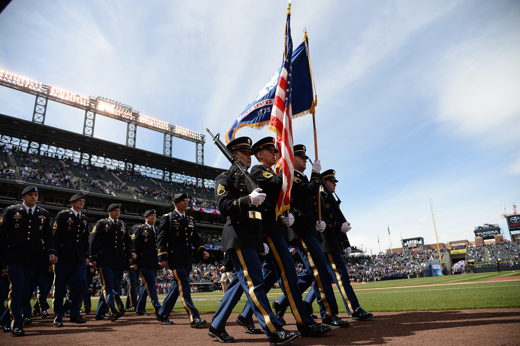 . Military personnel take the field for the opening ceremonies. (Photo by Hyoung Chang/The Denver Post)