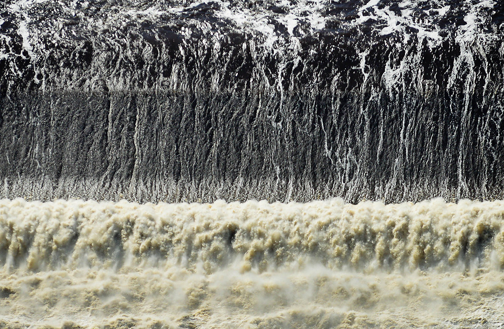 . High water rages at St. Anthony Falls on the Mississippi River in downtown Minneapolis. (Pioneer Press: Ben Garvin)
