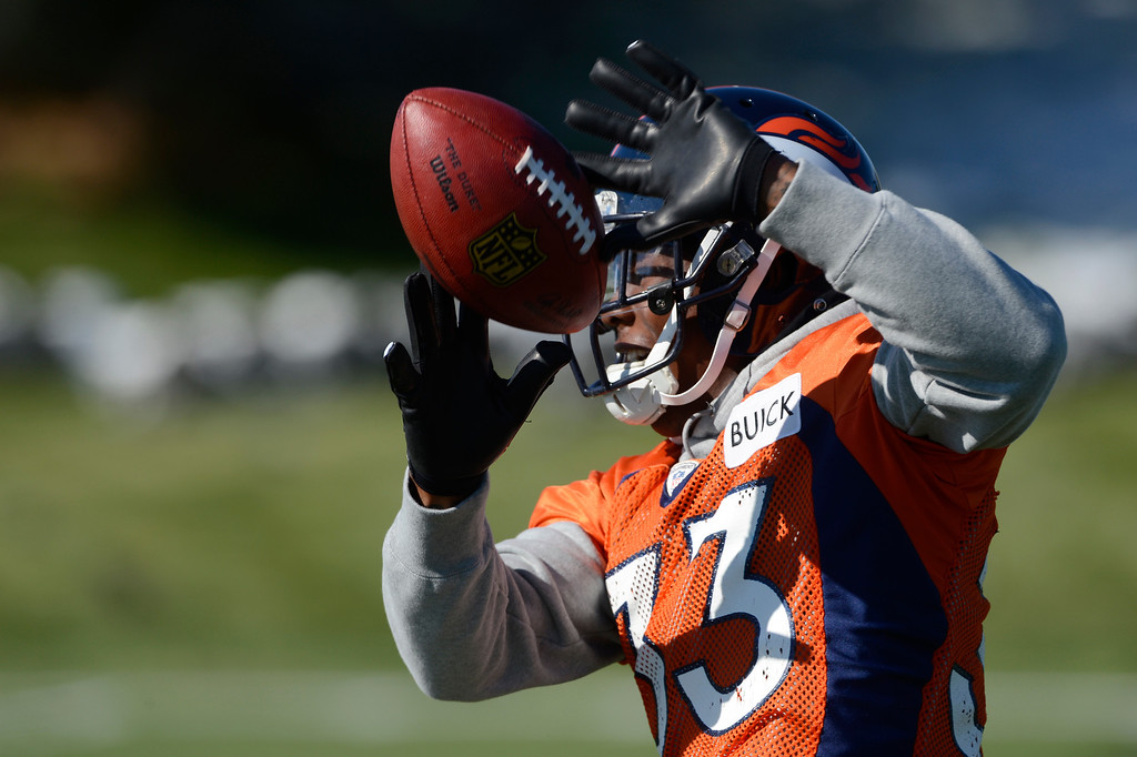 . Denver Broncos safety, Duke Ihenacho, tries to get a handle on the ball at practice Friday morning, October 18, 2103.  (Photo By Andy Cross/The Denver Post)