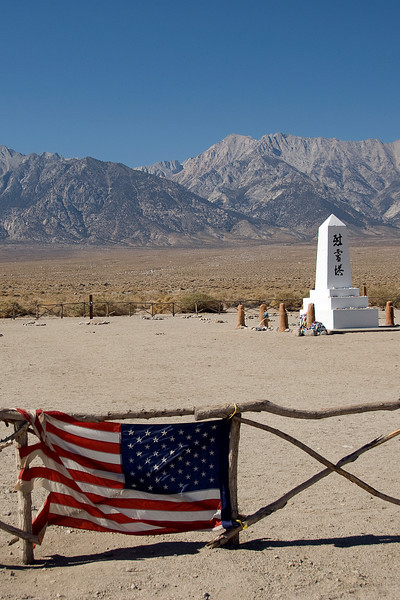 American flag near the monument at Manzanar Cemetery in California
