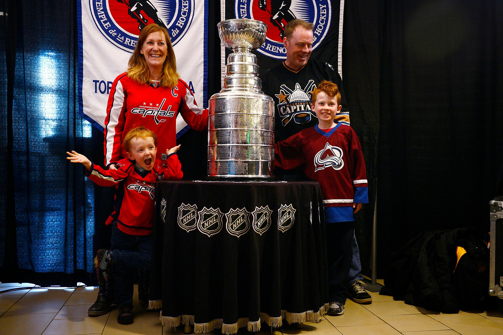 . DENVER, CO - MARCH 24: Andrew and Wendy Ware pose with their kids Carter, 8, and Liam, 4, in front of the Stanley Cup before the first period of action. Colorado Avalanche versus the Vancouver Canucks at the Pepsi Center. (Photo by AAron Ontiveroz/The Denver Post)