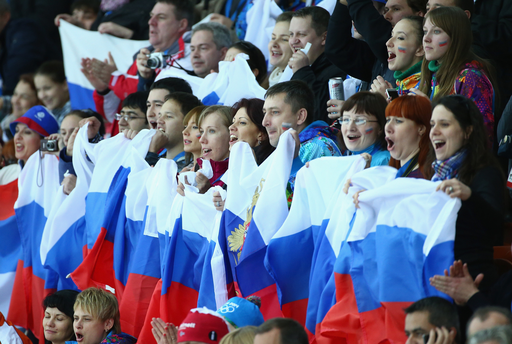. Fans cheer during the Men\'s 5000m Speed Skating event during day 1 of the Sochi 2014 Winter Olympics at Adler Arena Skating Center on February 8, 2014 in Sochi, Russia.  (Photo by Robert Cianflone/Getty Images)