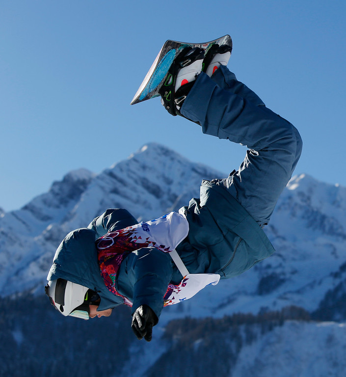 . Russia\'s Alexey Sobolev takes a jump during Men\'s snowboard slopestyle qualifying at the Rosa Khutor Extreme Park ahead of the 2014 Winter Olympics, Thursday, Feb. 6, 2014, in Krasnaya Polyana, Russia. (AP Photo/Sergei Grits)