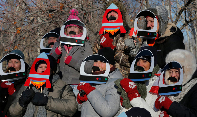 . Relatives and friends of  Canadian astronaut Chris Hadfield, crew member of the mission to the International Space Station, ISS,  pose near an astronaut\'s hotel prior the launch of Soyuz-FG  rocket at the Russian leased Baikonur cosmodrome, Kazakhstan, Wednesday, Dec. 19, 2012.  (AP Photo/Dmitry Lovetsky)
