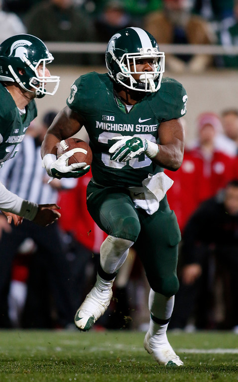 . Michigan State\'s Jeremy Langford rushes against Nebraska during the fourth quarter of an NCAA college football game, Saturday, Oct. 4, 2014, in East Lansing, Mich. Michigan State won 27-22. (AP Photo/Al Goldis)