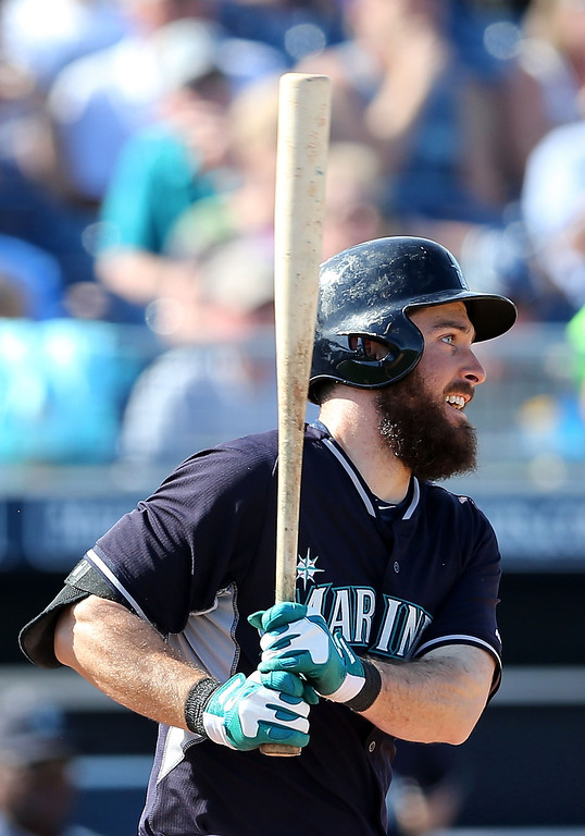 . Dustin Ackley #13 of the Seattle Mariners hits a three RBI double against the Colorado Rockies during the fifth inning of the spring training game at Peoria Stadium on March 3, 2014 in Peoria, Arizona.  (Photo by Christian Petersen/Getty Images)