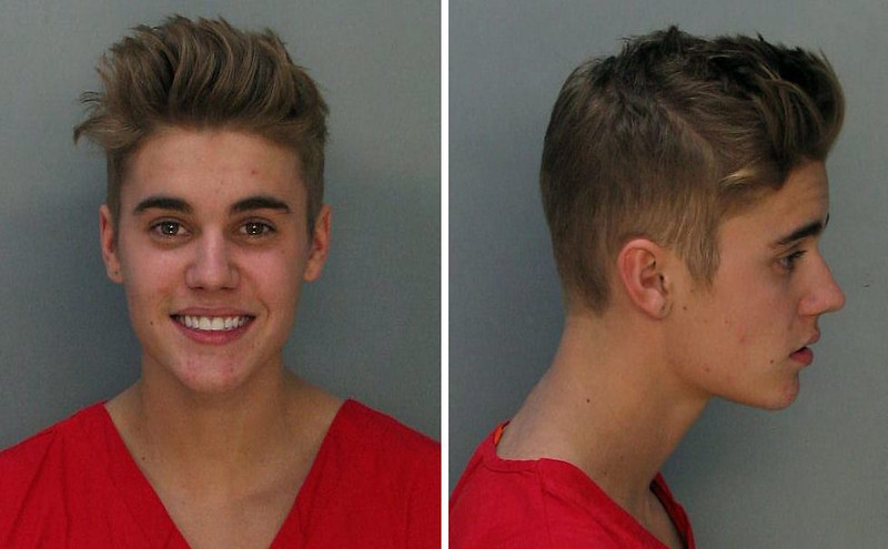 . A handout combination of booking images released by the Miami-Dade Corrections & Rehabilitation Dept. showing Canadian singer Justin Bieber who was arrested early in the morning of 23 January on charges of driving under the influence, driving with an expired license and resisting arrest following an alleged drag racing incident in Miami Beach, Florida, USA, 23 January 2014.  EPA/MIAMI-DADE CORRECTIONS & REHABILITATION DEPARTMENT /