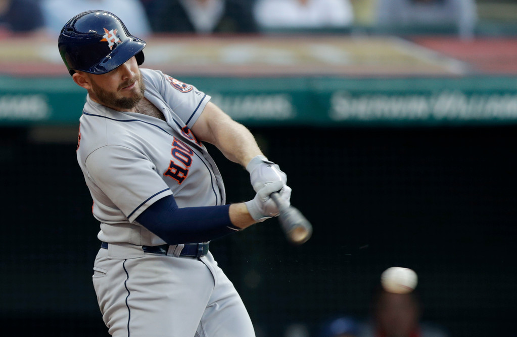 . Houston Astros\' Max Stassi hits an RBI-single off Cleveland Indians relief pitcher Tyler Olson in the sixth inning of a baseball game, Thursday, May 24, 2018, in Cleveland. Carlos Correa scored on the play. (AP Photo/Tony Dejak)