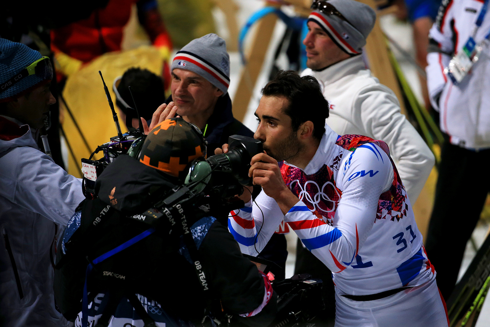 . Martin Fourcade of France kisses a TV camera as he celebrates after the Men\'s Individual 20 km during day six of the Sochi 2014 Winter Olympics at Laura Cross-country Ski & Biathlon Center on February 13, 2014 in Sochi, Russia.  (Photo by Richard Heathcote/Getty Images)