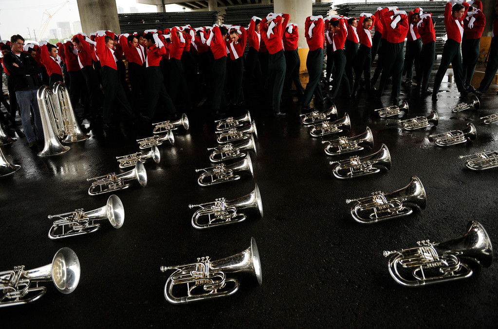 . Musicians from the Santa Clara Vanguard corps warmed up beneath the Colfax Avenue viaduct Saturday night. Drums Along the Rockies drum and bugle corps organizers elected to hold an abbreviated version of the competition at Sport Authority Field at Mile High due to the rain Saturday night, July 7, 2012. Karl Gehring/The Denver Post
