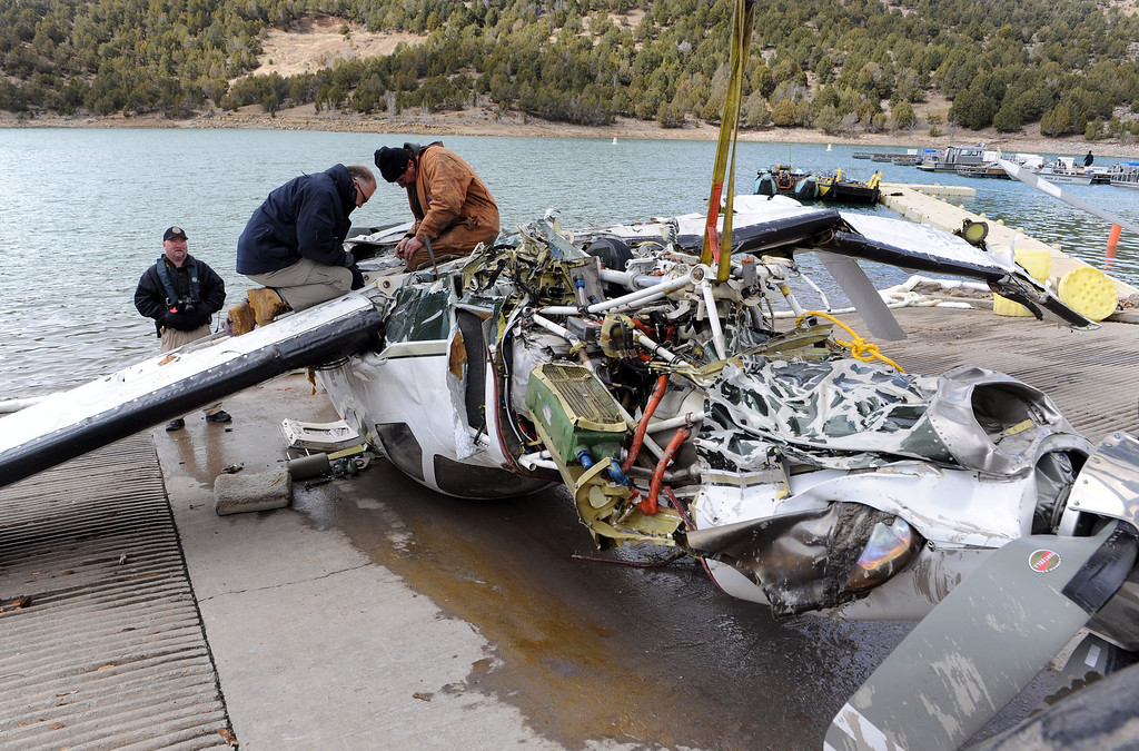 . Ouray County and Federal officials survey the damage of a small aircraft Thursday March 27, 2014, at the Ridgway Reservoir near Ridgway, Colo., The plane crashed last Saturday March 22, 2014 killing five people. (Photo by William Woody/Provided by Ouray County)