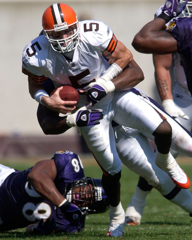 . News-Herald file Cleveland quarterback Jeff Garcia is sacked by the Baltimore defense yesterday.