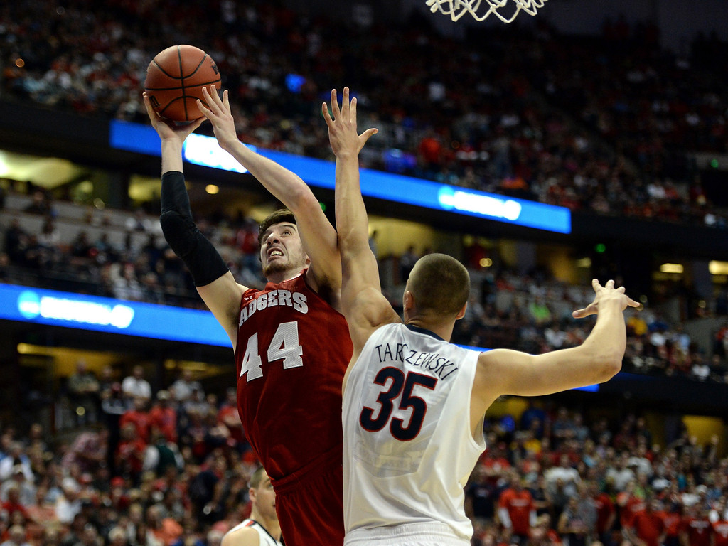 . Frank Kaminsky #44 of the Wisconsin Badgers goes up for a shot against Kaleb Tarczewski #35 of the Arizona Wildcats in the second half during the West Regional Final of the 2014 NCAA Men\'s Basketball Tournament at the Honda Center on March 29, 2014 in Anaheim, California.  (Photo by Harry How/Getty Images)