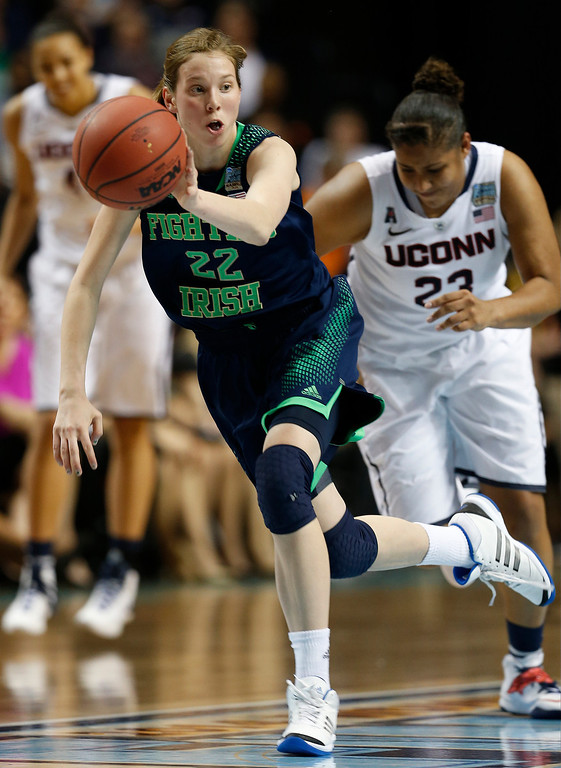 . Notre Dame guard Madison Cable (22) brings the ball up court against Connecticut during the second half of the championship game in the Final Four of the NCAA women\'s college basketball tournament, Tuesday, April 8, 2014, in Nashville, Tenn. (AP Photo/Mark Humphrey)