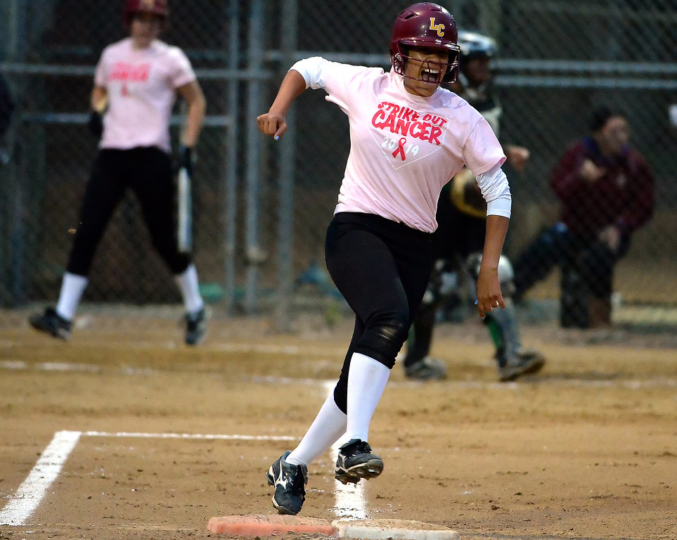 . La Canada\'s Olivia Leyva reacts after hitting a three run home run in the first inning of a prep softball game against Monrovia at La Canada High School in La Canada, Calif., on Friday, April 25, 2014.  (Keith Birmingham Pasadena Star-News)