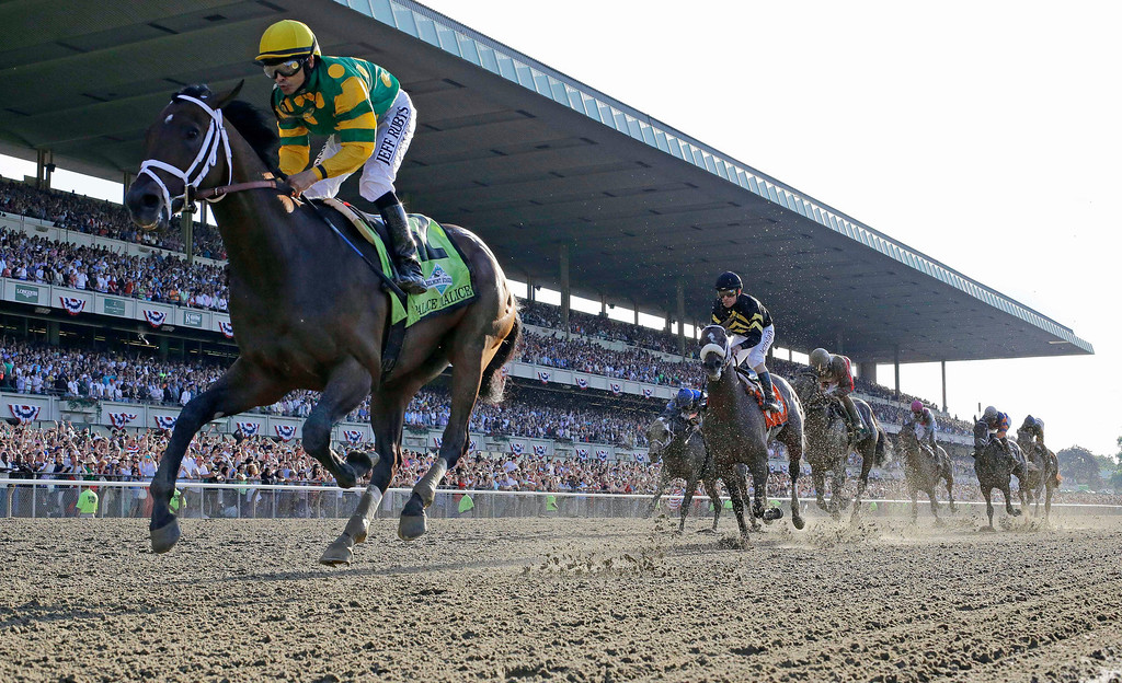. Palace Malice, left, ridden by jockey Mike Smith, crosses the finish line to win the 145th Belmont Stakes horse race at Belmont Park Saturday, June 8, 2013, in Elmont, N.Y. (AP Photo/Julio Cortez)