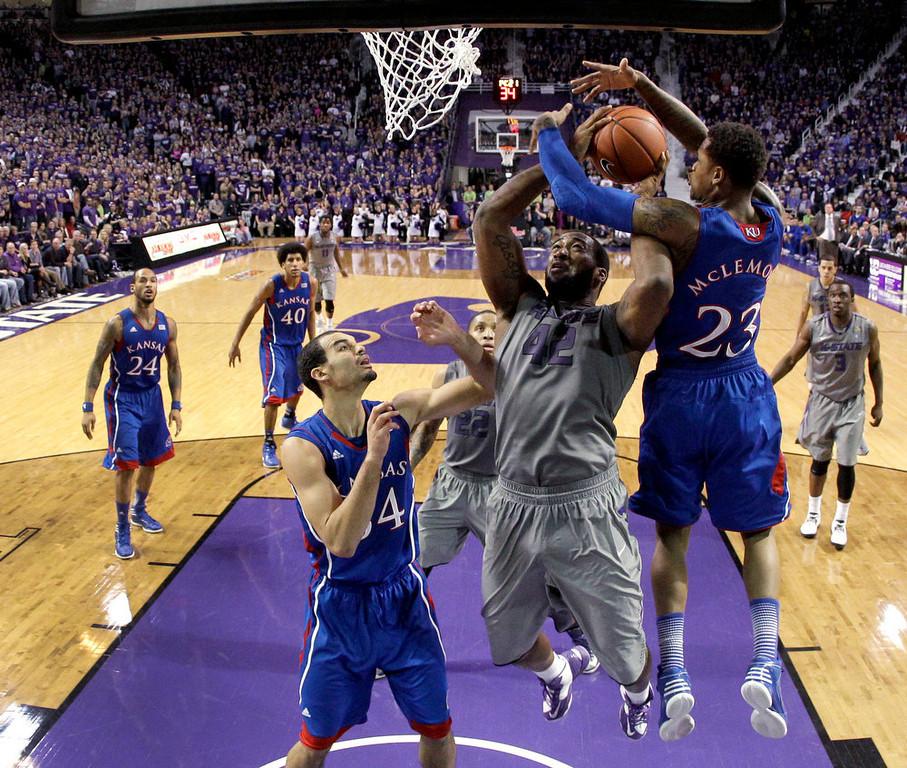 . Kansas guard Ben McLemore (23) blocks a shot by Kansas State forward Thomas Gipson (42) during the second half of an NCAA college basketball game Tuesday, Jan. 22, 2013, in Manhattan, Kan. Kansas won 59-55. (AP Photo/Charlie Riedel)