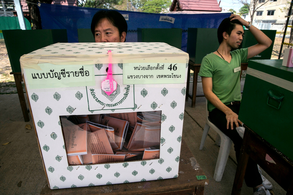 . Election officials wait for voters during the general elections on February 2, 2014 in Bangkok, Thailand.  Anti - government protesters took over government buildings where ballot boxes were stored as an attempt to derail the elections. Bangkok Shutdown has been in effect for over two weeks as the anti-government protesters continue to block major intersections. The Thai government imposed a 60-day state of emergency in Bangkok and the surrounding provinces in an attempt to cope with the on-going political turmoil however this decree has had no effect on the mass protests.  (Photo by Paula Bronstein/Getty Images)
