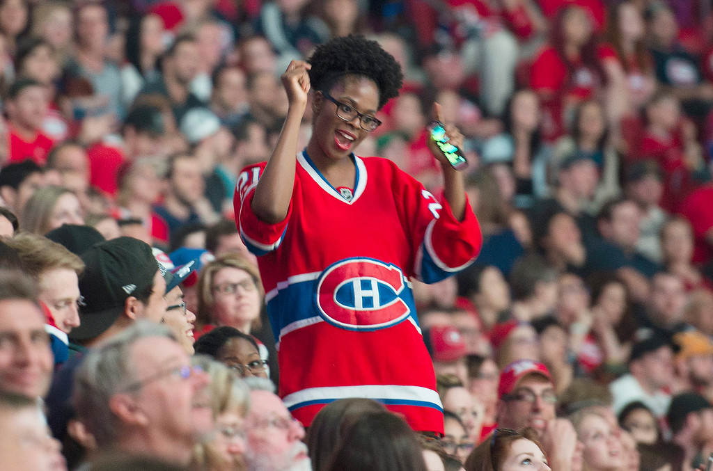 . A Montreal Canadiens fan dances as she watches the broadcast of Game 6 of the NHL hockey Stanley Cup Eastern Conference finals between the Canadiens and the New York Rangers, on the big screen at the Bell Centre in Montreal, Thursday, May 29, 2014. (AP Photo/The Canadian Press, Graham Hughes)