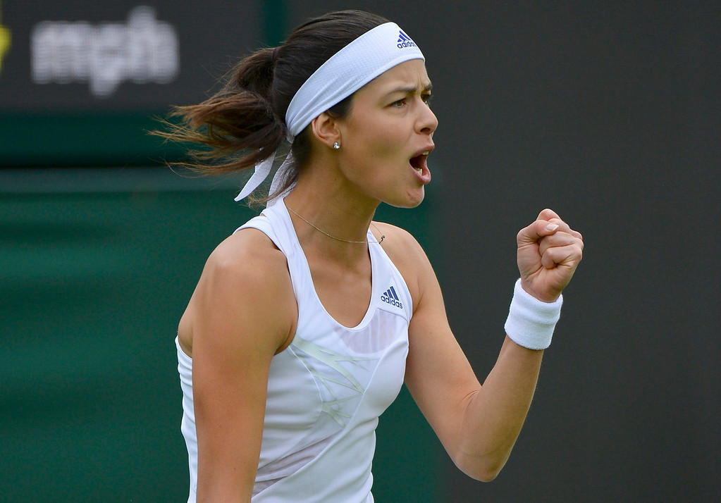 . Ana Ivanovic of Serbia reacts after winning a point during her women\'s singles tennis match against Virginie Razzano of France at the Wimbledon Tennis Championships, in London June 24, 2013.  REUTERS/Toby Melville