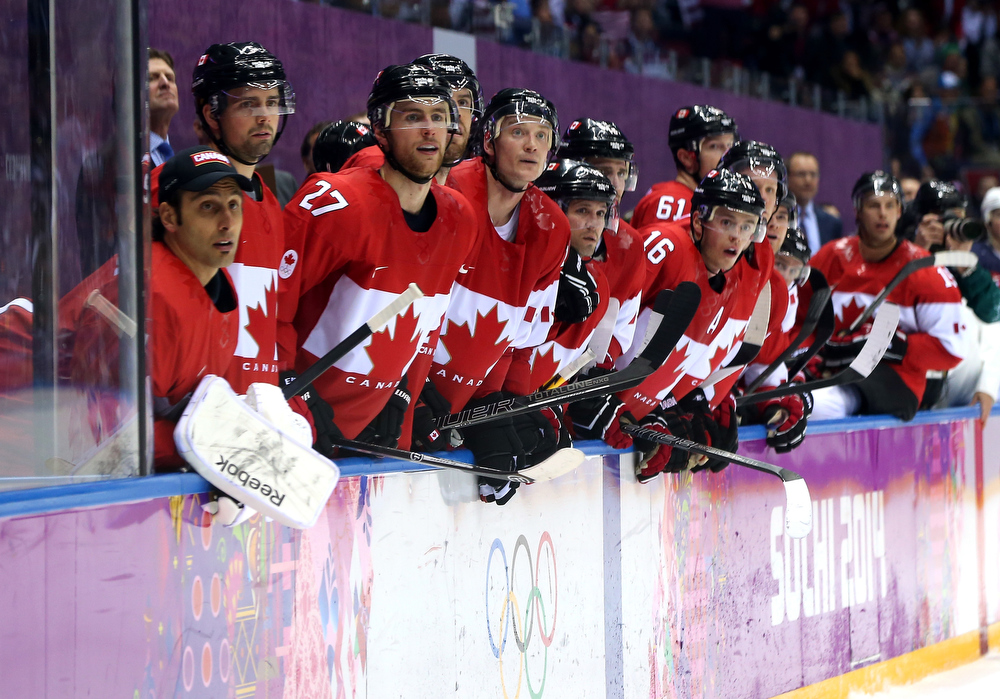 . The Canada bench looks on as the seconds run out during the Men\'s Ice Hockey Semifinal Playoff against the United States on Day 14 of the 2014 Sochi Winter Olympics at Bolshoy Ice Dome on February 21, 2014 in Sochi, Russia.  (Photo by Bruce Bennett/Getty Images)