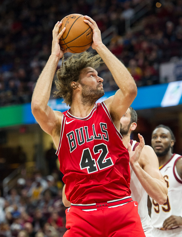 . Chicago Bulls\' Robin Lopez (42) drives past Cleveland Cavaliers\' Kevin Love during the first half of an NBA preseason basketball game in Cleveland, Tuesday, Oct. 10, 2017. (AP Photo/Phil Long)