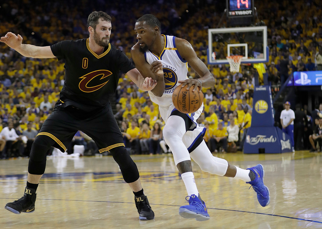 . Golden State Warriors forward Kevin Durant (35) drives on Cleveland Cavaliers forward Kevin Love (0) during the first half of Game 2 of basketball\'s NBA Finals in Oakland, Calif., Sunday, June 4, 2017. (AP Photo/Marcio Jose Sanchez)