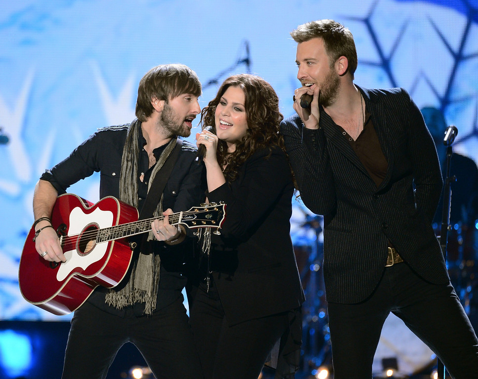. LAS VEGAS, NV - DECEMBER 10:  (L-R) Musicians Dave Haywood, Hillary Scott, and Charles Kelley of Lady Antebellum perform onstage during the 2012 American Country Awards at the Mandalay Bay Events Center on December 10, 2012 in Las Vegas, Nevada.  (Photo by Mark Davis/Getty Images)
