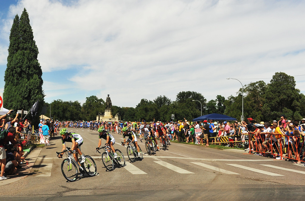 . Cyclists pass by City Park during the 75-mile 7th stage of the 2013 USA Pro Challenge race in Denver, Colorado on August 25, 2013. (Photo by Hyoung Chang/The Denver Post)