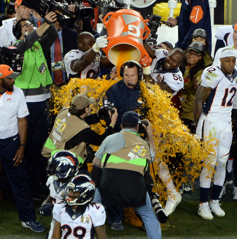 . SANTA CLARA, CA - FEBRUARY 7: Von Miller (58) of the Denver Broncos dumps Gatorade on head coach Gary Kubiak of the Denver Broncos as the Broncos win the Super Bowl.  The Broncos defeated the Panthers 24 to 10 in Super Bowl 50.  The Denver Broncos played the Carolina Panthers in Super Bowl 50 at Levi\'s Stadium in Santa Clara, Calif. on February 7, 2016. (Photo by RJ Sangosti/The Denver Post)