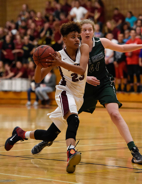 . THORNTON, CO - MARCH 01: Horizon Isabella Allen (23) drives past Pine Creek Courtney Stanton (44) during the Girls Class 5A Sweet 16 game March 1, 2016 at Horizon HS. (Photo By John Leyba/The Denver Post)