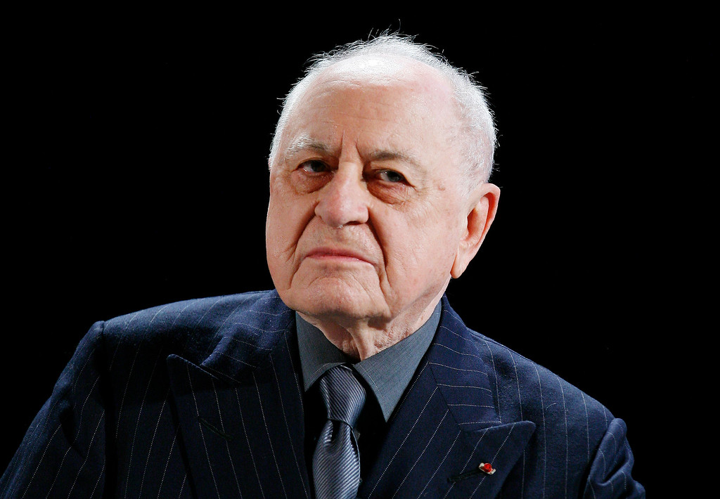 . FILE - In this Feb.23 2009 file photo, French businessman Pierre Berge and former partner of late fashion designer Yves Saint-Laurent speaks to the media. Pierre Berge, an influential French businessman and philanthropist who was fashion designer Yves Saint Laurent\'s romantic and business partner and championed gay rights, died Sept. 8 at 86. (AP Photo/Jacques Brinon, File)
