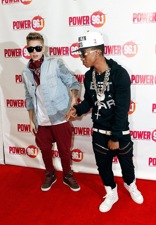 . ATLANTA, GA - DECEMBER 12:  Justin Bieber and Lil Twist attend Power 96.1\'s Jingle Ball 2012 at the Philips Arena on December 12, 2012 in Atlanta.  (Photo by Butch Dill/Getty Images for Jingle Ball 2012)