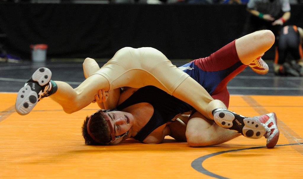 . DENVER, CO. - FEBRUARY 21: Classical Academy wrestler Nathaniel Johnston, bottom, was pinned by Holy Family sophomore Julian Prieto, top, in the 120-pound weight class in 3A Thursday. The CHSAA State Wrestling Tournament kicked off Thursday, February 21, 2013 at the Pepsi Center in Denver. His  (Photo By Karl Gehring/The Denver Post)