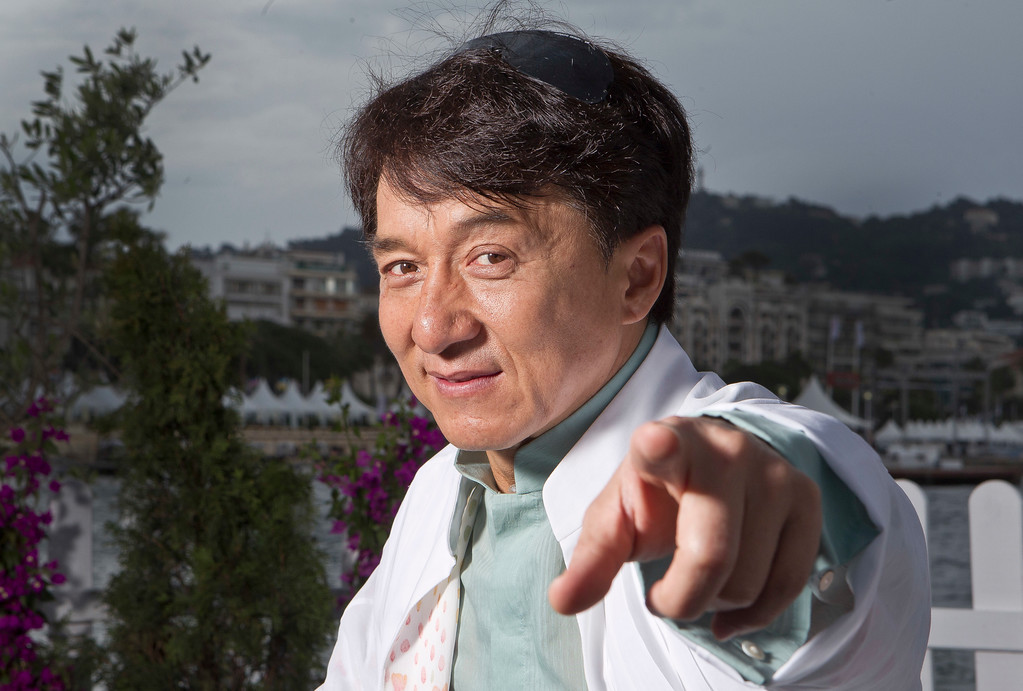 . Actor Jackie Chan poses for portraits at the American Pavilion during the 65th international film festival, in Cannes, southern France, Saturday, May 19, 2012. (AP Photo/Joel Ryan)