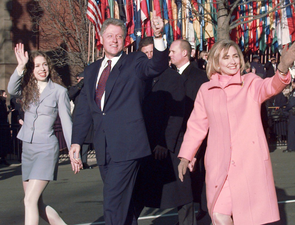 . President Clinton, first lady Hillary Clinton, right, and their daughter Chelsea wave to supporters during the Inauguration Parade in Washington, after Clinton was sworn in Monday, Jan. 20, 1997.  (AP Photo/Greg Gibson)