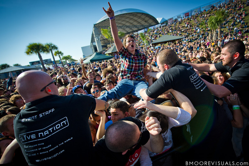 "A fan body surfs over the crowd while A Day To Remember perform in support of ""What Separates Me from You"" on December 5, 2010 during 97X Next Big Thing at 1-800-ASK-GARY Amphitheatre in Tampa, Florida"