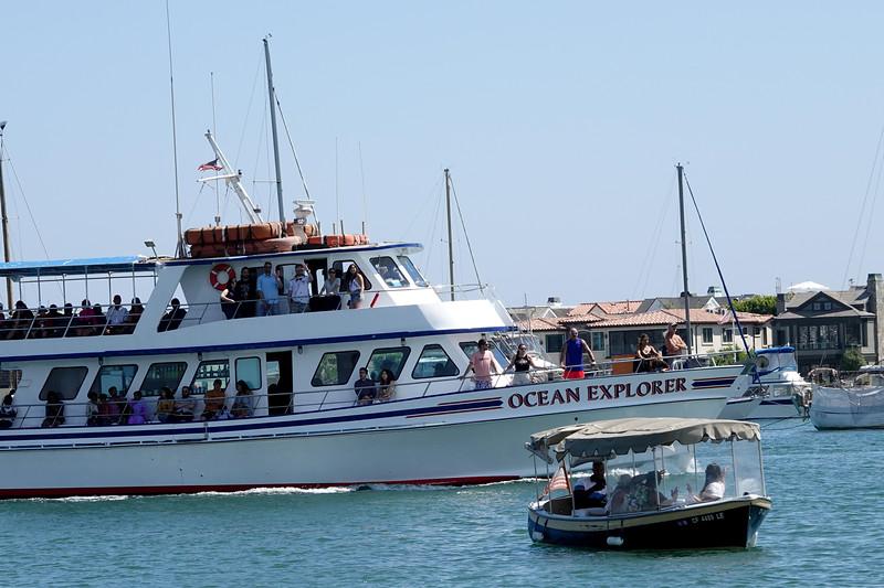 Two boats by the bay on Balboa Island, California