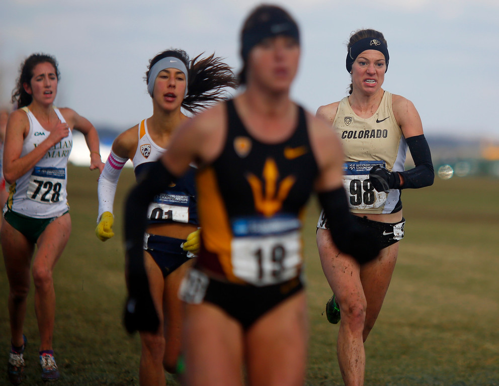 . TERRE HAUTE, IN - NOVEMBER 23: University of Colorado\'s Shalaya Kipp, right, crosses the finish line during the NCAA Cross Country Championships at Lavern Gibson Championship Cross Country Course on Saturday, November 23, 2013, in Terre Haute, Indiana. (Photo by Aaron P. Bernstein/Special to The Denver Post)