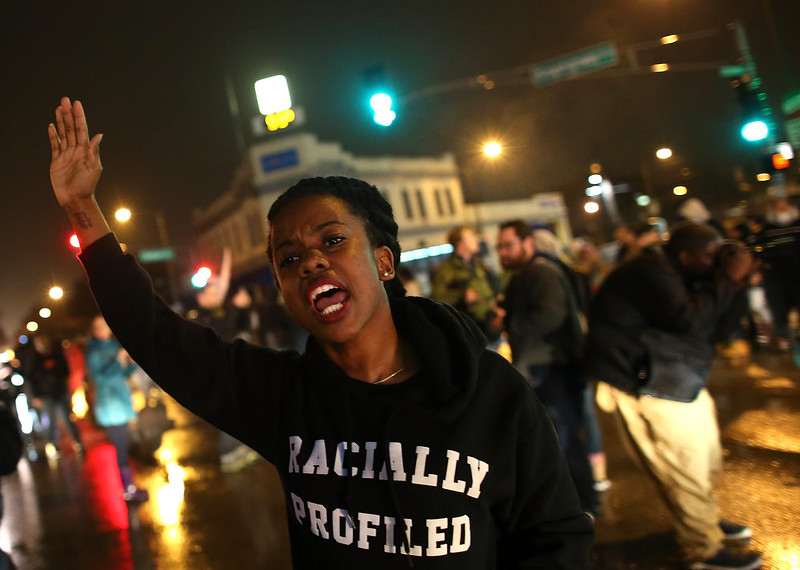. Demonstrators block an intersection while protesting the shooting death of 18-year-old Michael Brown on November 23, 2014 in St. Louis, Missouri. Tensions in Ferguson remain high as a grand jury is expected to decide this month if Ferguson police officer Darren Wilson should be charged in the shooting death of Michael Brown.  (Photo by Justin Sullivan/Getty Images)